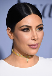 Kim Kardashian polished off her look with a diamond and gold choker.