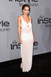 Zoe Kravitz was bedroom-chic at the InStyle Awards in a sheer white Calvin Klein maxi dress with a diamond-shaped cutout.
