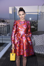 Jennifer Morrison's yellow Edie Parker acrylic bag made a gorgeous contrast to her red frock.