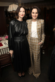 Michelle Dockery went the masculine-chic route in a tan plaid pantsuit by Zimmermann at the InStyle Badass Women dinner.