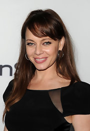 Melinda Clarke's lipstick at the 2011 Toronto International Film Festival was perfectly pink. To try her look at home, we recommend a sheer, moisturizing formula like Covergirl LipPerfection Lipcolor. There are a range pink shades to complement almost any skin tone.