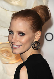 Jessica Chastain wore her hair in a classic, oversized bun at the Toronto International Film Festival. To recreate her look, smooth hair back and pull up into a high ponytail. Next, twist tresses and wrap around the base of the ponytail. To finish, secure ends with a few bobby pins.