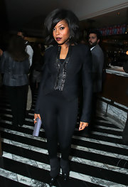 Taraji sports a sleek black blazer with her moto-chic ensemble for the Miss Golden Globes Party.