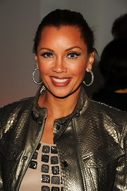 Actress Vanessa Williams paired her sleek bun with classic diamond hoop earrings.