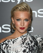 Katie added major drama to her look with satin red lips that really popped against her black and white printed dress.