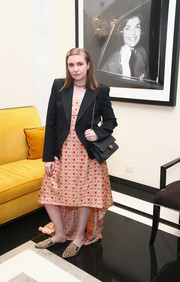 Lena Dunham attended the InStyle March issue party looking cute in an embroidered peach high-low dress.