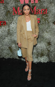 Ashley Madekwe donned a cropped khaki pantsuit for the InStyle Max Mara Women in Film celebration.