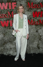 Elizabeth Debicki teamed a white pantsuit with a green polka-dot blouse for the InStyle Max Mara Women in Film celebration.