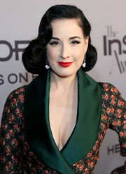 Dita Von Teese brought her signature retro style to the InStyle Awards with this vintage-glam 'do.