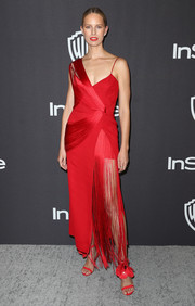 Karolina Kurkova was flapper-glam in a fringed red gown by Versace at the InStyle and Warner Bros. Golden Globes after-party.