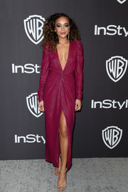 Ashley Madekwe turned up the heat in a burgundy Monique Lhuillier dress with a plunging neckline and a high slit at the InStyle and Warner Bros. Golden Globes after-party.