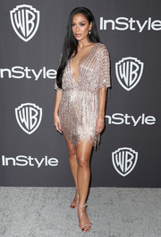 Nicole Scherzinger brought a high dose of sparkle to the InStyle and Warner Bros. Golden Globes after-party with this fringed rose-gold mini dress by Labourjoisie.