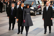 Michelle Obama walked the inaugural parade in this crisp patterned coat dress with an adorned empire waist.