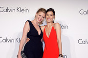 (L-R) Model Lara Stone and Hanneli Mustaparta attend the Calvin Klein Collection Hosts a special one-night exhibition entitled