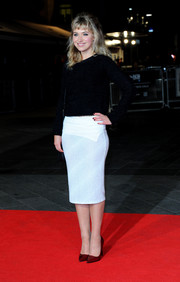 Imogen Poots was casual yet smart in a white pencil skirt and a black crewneck sweater during the 'Inside Llewyn Davis' screening in London.