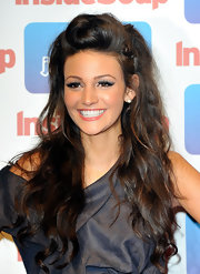 Michelle Keegan rocked some pretty fierce lashes at the Inside Soap Awards 2011. To recreate her bold look, sweep a pale, shimmery shadow across the lids and line the upper lash lines with a black eye pencil. Next, add a small amount of lash glue to false lash strips and position along the lash line. After glue has dried, add a few coats of mascara.