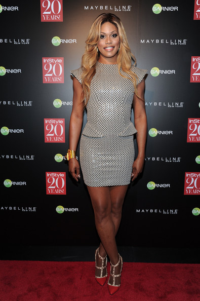 Laverne Cox added color to her outfit with a pair of red and white Valentino Rockstud pumps.