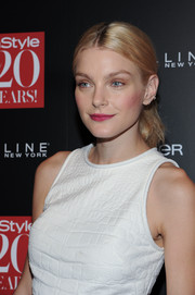 Jessica Stam infused some color into her look with a fuchsia lip and rouged-up cheeks.