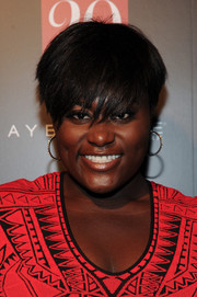 Danielle Brooks rocked a layered razor cut with long, full side-swept bangs at the InStyle 20th anniversary party.
