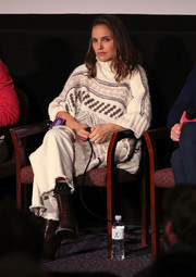 Natalie Portman teamed brown ankle boots with wide-leg jeans and a poncho for the special screening of 'Eating Animals.'