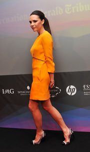 Victoria Beckham gives us yet another reason to envy her in her Chanel 2010 pumps. The cap toe pearl embellished pumps are a dream paired with a marigold shift dress.
