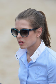 Charlotte Casiraghi finished off her look with blue cateye sunnies.