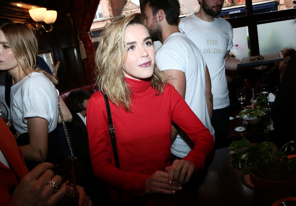 Kiernan Shipka bundled up in a red turtleneck for the Dior welcome party.