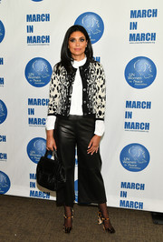 Rachel Roy styled her outfit with a pair of leopard-print Mary Janes.
