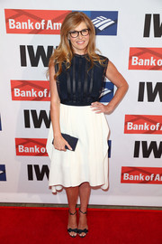 Connie Britton rounded out her look with a navy suede clutch.