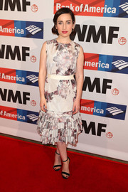 Zoe Lister Jones paired her dress with navy velvet sandals.