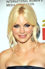 Anna Faris showed off a softer side with a loose center part bun.
