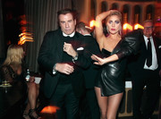 Lady Gaga looked flamboyant, as always, in a black Alexandre Vauthier Haute Couture leather mini dress with a single puffed sleeve during Interscope's Grammy after-party.