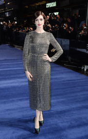 Anne Hathaway paired her dress with dark green platform pumps by Charlotte Olympia.