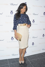 Tiffany Hines carried this cream leather clutch with her sophisticated pencil skirt.