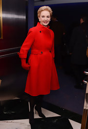 Carolina Herrera looked perfectly poised in a bright red wool coat at the 'Inventing David Geffen' premiere.