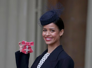 Gugu Mbatha-Raw dolled up with a net-accented hat for an investiture ceremony at Buckingham Palace.