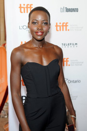 Lupita Nyong'o looked foxy in a strapless black corset top during the premiere of 'The Invisible Woman.'