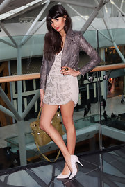 Jameela toughened up her feminine embellished frock with a cool cropped leather jacket.