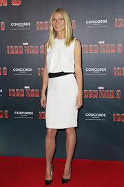 Gwyneth Paltrow showed off her perfectly toned limbs with this sleeveless white dress that featured a single pleated bodice and an open back.
