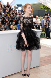 Emma Stone looked breathtakingly romantic at the 'Irrational Man' photocall in an Oscar de la Renta LBD rendered in lace and swirls of organza.