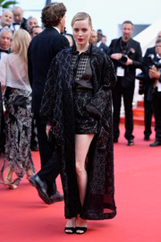 Melissa George worked the 'Irrational Man' red carpet in Cannes wearing a Schiaparelli Couture ensemble, consisting of a black jacquard robe, matching shorts, and a button-down shirt.