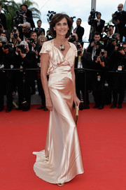 Ines de la Fressange chose a draped champagne evening dress for the 'Irrational Man' premiere in Cannes.