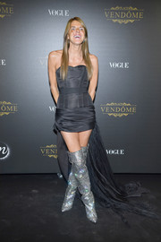 Anna dello Russo looked ageless in a strapless black corset dress with a long train at the Irving Penn exhibition.