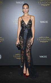 Shanina Shaik gave her black look a subtle pop of color with a pair of red velvet Louboutins.