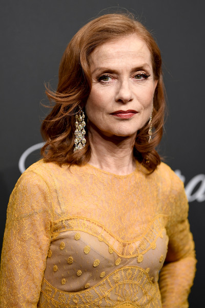Isabelle Huppert Medium Curls [hair,face,hairstyle,head,lady,beauty,yellow,fashion,long hair,blond,caroline scheufele,isabelle huppert,rihanna,chopard space party - photocall,cannes,france,port canto,chopard space party,chopard,cannes film festival]