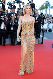 Eva Herzigova shone in a beaded gold column dress by Roberto Cavalli Couture at the Cannes Film Festival opening gala.