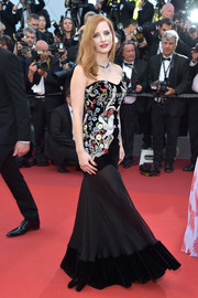 Jessica Chastain attended the Cannes Film Festival opening gala wearing an Alexander McQueen strapless gown with an embroidered bodice and a sheer skirt.