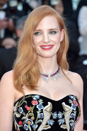 Jessica Chastain complemented her strapless dress with a ruby and diamond statement necklace by Piaget.
