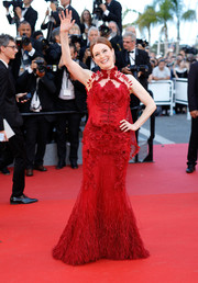 Julianne Moore went the frilly route in a feathered and embroidered red mermaid gown by Givenchy Couture at the Cannes Film Festival opening gala.