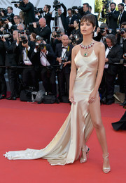 Emily Ratajkowski hit the Cannes Film Festival opening gala wearing a slinky champagne slip gown by Twinset.